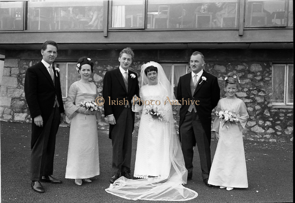"16/09/1967<br /> 09/16/1967<br /> 16 September 1967<br /> Wedding of Mr Francis W. Moloney, 28 The Stiles Road, Clontarf and Ms Antoinette O'Carroll, ""Melrose"", Leinster Road, Rathmines at Our Lady of Refuge Church, Rathmines, with reception in Colamore Hotel, Coliemore Road, Dalkey. Image shows (l-r); Unnamed gentleman; Matron of Honour Gladys McGloughlin; the Bride and Groom; Bestman, Michael Power and unnamed Bridesmaid outside hotel."