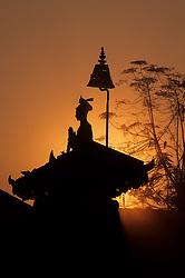 Asia, Nepal, Kathmandu Valley, Bhaktapur. King Bhupatindra Malla's column at sunset; he ruled from 1696 to 1722.