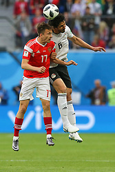 June 19, 2018 - Saint Petersburg, Russia - Aleksandr Golovin (L) of the Russia national football team and Ahmed Hegazy of the Egypt national football team vie for the ball during the 2018 FIFA World Cup match, first stage - Group A between Russia and Egypt at Saint Petersburg Stadium on June 19, 2018 in St. Petersburg, Russia. (Credit Image: © Igor Russak/NurPhoto via ZUMA Press)