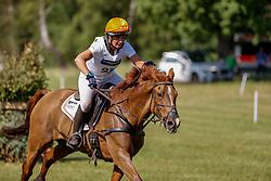LUHMÜHLEN - Longines CCI5*-L/CCI4*-S Meßmer Trophy<br /> Deutsche Meisterschaften 2021<br /> <br /> KHODDAM-HAZRATI Katrin (AUT), DSP Cosma <br /> Teilprüfung Gelände<br /> CCI4*-S Meßmer Trophy<br /> Cross-Country<br /> <br /> Luhmühlen, Turniergelände<br /> 19. June 2021<br /> © www.sportfotos-lafrentz.de/Stefan Lafrentz