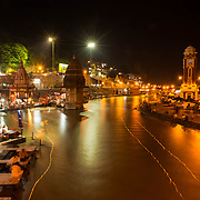 The candle lights of ceremonial diyas float down the Ganges at the end of the nightly Ganga aarti at Har Ki Pauri ghat, Haridwar, Uttarakhand, India.
