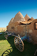 """Pictures of the beehive adobe buildings of Harran, south west Anatolia, Turkey.  Harran was a major ancient city in Upper Mesopotamia whose site is near the modern village of Altınbaşak, Turkey, 24 miles (44 kilometers) southeast of Şanlıurfa. The location is in a district of Şanlıurfa Province that is also named """"Harran"""". Harran is famous for its traditional 'beehive' adobe houses, constructed entirely without wood. The design of these makes them cool inside. 33 .<br /> <br /> If you prefer to buy from our ALAMY PHOTO LIBRARY  Collection visit : https://www.alamy.com/portfolio/paul-williams-funkystock/harran.html<br /> <br /> Visit our TURKEY PHOTO COLLECTIONS for more photos to download or buy as wall art prints https://funkystock.photoshelter.com/gallery-collection/3f-Pictures-of-Turkey-Turkey-Photos-Images-Fotos/C0000U.hJWkZxAbg ."""