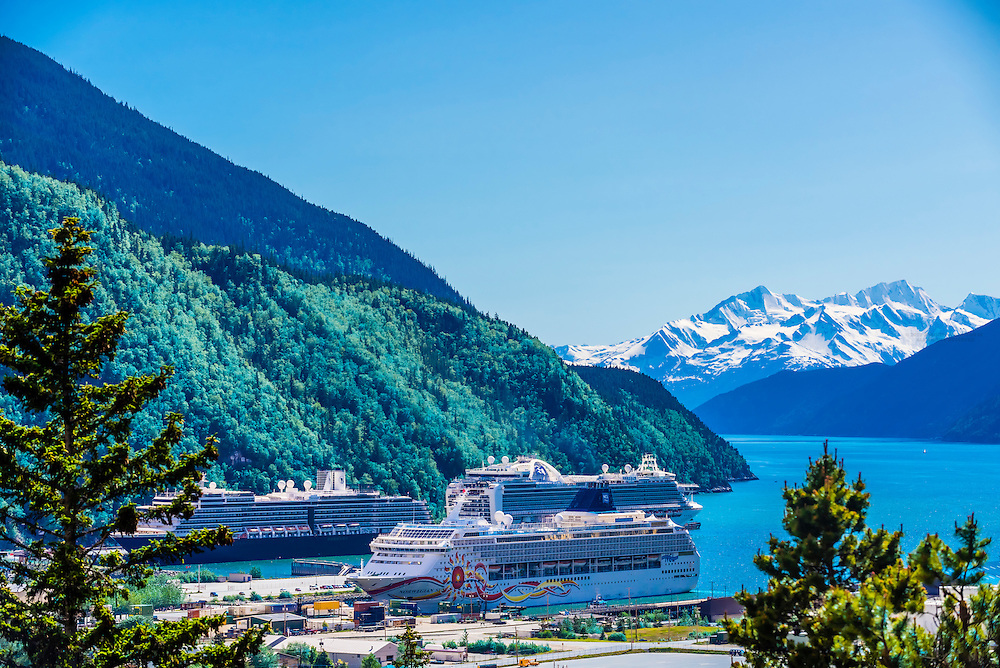 Overview of Skagway, Alaska USA with three cruise ships in port.