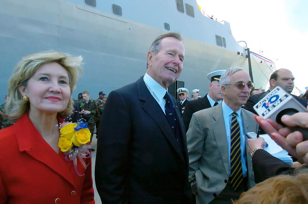 Ingleside, TX January 14, 2006: (L to R) U.S. Senator Kay Bailey Hutchison, former U.S. President George H.W. Bush and Deputy Secretary of Defense, Gordon R. England, greet guests at the commissioning of the USS San Antonio (LPD-17) at the Ingleside Navy Station Saturday.  ©Bob Daemmrich /