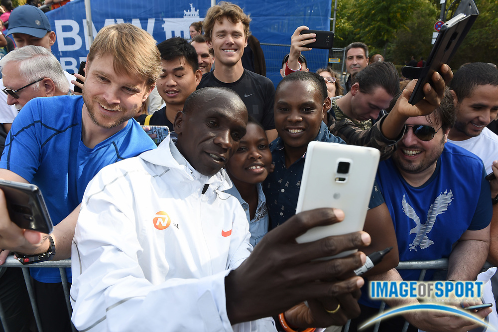 Eliud Kipchoge (KEN) poses for a selfie after winning the 45th Berlin Marathon in a world best 2:01.39 in Berlin, Germany, Sunday, Sept. 16, 2018.. Kipchoge  broke the previous record by 1:18 set in 2014  by Dennis Kimetto. It is the largest single improvement on the marathon world record since Derek Clayton improved the mark by 2:23 in 1967. (Jiro Mochizuki/Image of Sport)