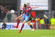 Matthew Lund of Scunthorpe United (7) and Danny Devine of Bradford City (24) clash in the air during the EFL Sky Bet League 1 match between Scunthorpe United and Bradford City at Glanford Park, Scunthorpe, England on 27 April 2019.