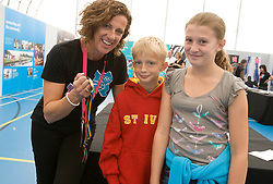 ODA Open House, Olympic gold medalists Sally Gunnell shows off her gold medal to Jack Shale & Rosie Shale. Picture taken 19th September 2008 by David Poultney