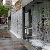 USA, Washington, Seattle. Refreshing Waterfall structure in Westlake Park;