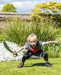 Medieval Day. Dirleton Castle, East Lothian, Scotland, United Kingdom, 11 May 2019. Pictured:  Medieval Day: Finn, aged 6 years, gets into the fighting spirit. Historic Environment Scotland family fun day at the Living Medieval Village by Saltire History Society in the castle gardens. <br /> <br /> Sally Anderson   EdinburghElitemedia.co.uk
