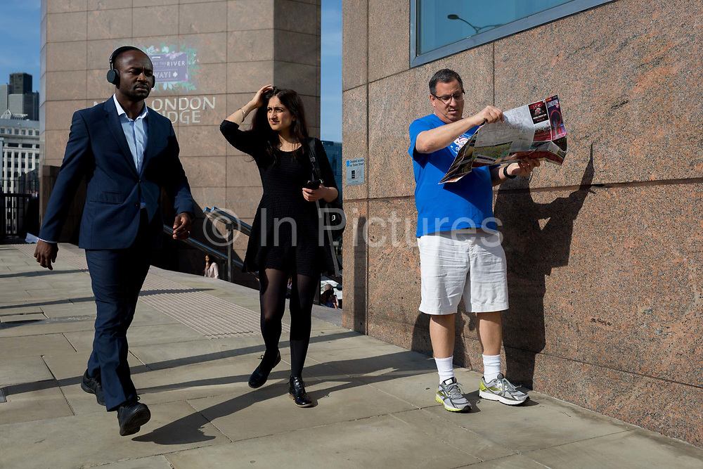 Commuters and other pedestrians walk over London Bridge, the oldest of the capitals crossing over the river Thames between the capitals financial district, the City of London, and Southwark on the south bank, on 6th June 2018, in London, UK.