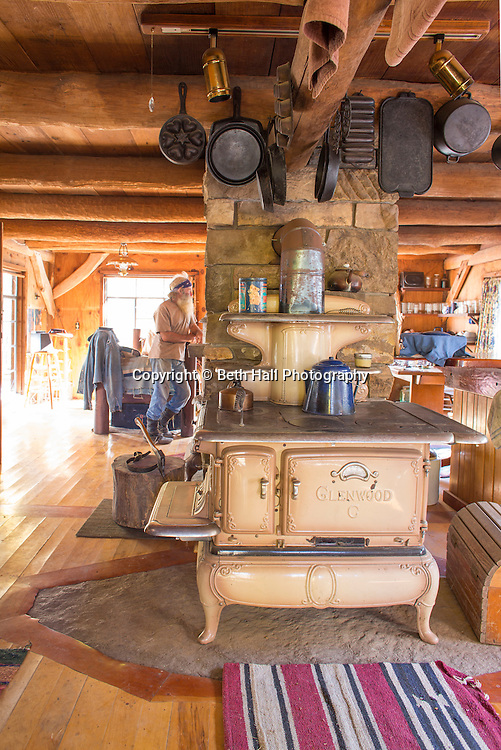 Interior looking from the kitchen to the living area of the home of Robert Runyon in Sugar Tree Hollow in Winslow, Arkansas, for Out Here Magazine. Photo by Beth Hall