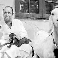 British author William Dalrymple with some of his pets incliding cockatiel Albina at home in New Delhi...Photo: Tom Pietrasik.New Delhi. India.December 19th 2009