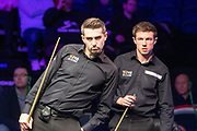 Mark Selby comes to the table for the first time and has Jack Lisowski looking over his shoulder during the World Snooker 19.com Scottish Open Final Mark Selby vs Jack Lisowski at the Emirates Arena, Glasgow, Scotland on 15 December 2019.