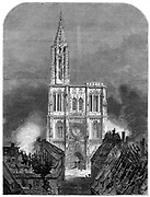 Franco-Prussian War 1870-1871: Strasbourg Cathedral during the final bombardment of the city, 1870. From 'The Graphic' (London, 15 October 1870). Wood engraving.