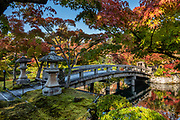 """Fall foliage colors reflect in Hojo Pond at Eikando (formally known as Zenrinji Temple), in Kyoto, Japan. Eikando belongs to the Jodo sect of Japanese Buddhism. It is found just north of the large temple complex of Nanzenji. A court noble of the Heian Period (710-1185) donated his villa to a priest, who converted it into a temple named Zenrinji (""""temple in a calm grove""""). At its founding, Zenrinji was part of the Shingon sect. In the 11th century, Zenrinji had a popular head priest named Eikan, after whom the temple is popularly named Eikando (""""Eikan Hall"""")."""
