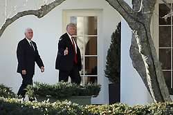 WASHINGTON, DC - JANUARY 25: AFP OUT U.S. President Donald Trump (R) and Vice President Mike Pence return to the White House after visiting the Department of Homeland Security January 25, 2017 in Washington, DC. While at the department, Trump signed two executive orders related to domestic security and to begin the process of building a wall along the U.S.-Mexico border. (Photo by Chip Somodevilla/Getty Images)