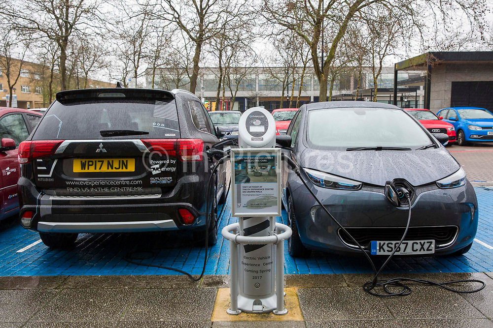 Electric Vehicles charging using the POLAR Network charging points in Milton Keynes, United Kingdom. Chargemaster make and install the charging points in the UK through their POLAR Network, which gives access to over 6,000 charging points.