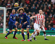 Marouane Fellaini of Man Utd (l) is challenged by Charlie Adam of Stoke city.Premier league match, Stoke City v Manchester Utd at the Bet365 Stadium in Stoke on Trent, Staffs on Saturday 21st January 2017.<br /> pic by Andrew Orchard, Andrew Orchard sports photography.