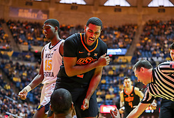 Jan 12, 2019; Morgantown, WV, USA; Oklahoma State Cowboys forward Maurice Calloo (2) celebrates with Oklahoma State Cowboys forward Cameron McGriff (12) during the first half against the West Virginia Mountaineers at WVU Coliseum. Mandatory Credit: Ben Queen-USA TODAY Sports