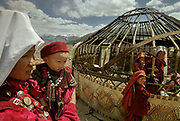 This yurt is being reassembled after it was shaken loose by the strong winds of the Little Pamir. At the summer camp of Moqur in Aq Jilga valley where our friend Mullah Bichek lives.<br /> <br /> Adventure through the Afghan Pamir mountains, among the Afghan Kyrgyz and into Pakistan's Karakoram mountains. July/August 2005. Afghanistan / Pakistan.