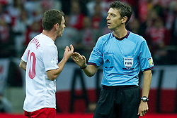 (L) Poland's Ludovic Obraniak (nr10) speaks with Referee Gianluca Rocchi during the 2014 World Cup Qualifying Group H football match between Poland and England at National Stadium in Warsaw on October 17, 2012...Poland, Warsaw, October 17, 2012..Picture also available in RAW (NEF) or TIFF format on special request...For editorial use only. Any commercial or promotional use requires permission...Photo by © Adam Nurkiewicz / Mediasport