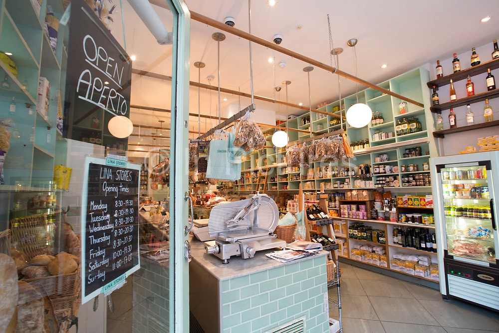 Interior of Italian delicatessen, Lina Stores, on 19th October 2015 in London, United Kingdom. Family-run Italian deli serving homemade pasta, cheese, cured meats, groceries and fresh coffee in the heart of Soho.