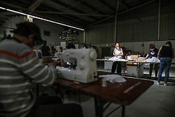 Women work in a temporary workshop producing facial masks installed in the exhibition center of Teste-de-Buch, in the south-east of France, on April 17, 2020, during a lockout in France aimed at check the spread of the COVID-19 pandemic caused by the new coronavirus. An ephemeral sewing workshop was set up in 48 hours within the La Teste-de-Buch (Gironde) exhibition center to manufacture nearly a million washable masks for the population. The production of the masks started on April 17, 2020. The company plans to produce around 30,000 masks per day.Photo by Thibaud Moritz/ABACAPRESS.COM
