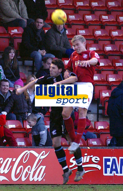 Photo: Dave Linney.<br />Walsall v Scunthorpe United. Coca Cola League 1. 11/02/2006Walsall's heads .Craig Pead (R) beats   Michael Rose in the air