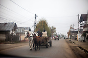 A horse carriage at the main road in Marginenii de Jos