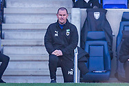 AFC Wimbledon manager Mark Robinson takes the knee before the EFL Sky Bet League 1 match between AFC Wimbledon and Hull City at Plough Lane, London, United Kingdom on 27 February 2021.