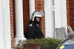 © Licensed to London News Pictures. 18/01/2019. London, UK. Armed police at a residential address in Balham, south London where police are negotiating with a man who is inside the house with a knife. Photo credit: Peter Macdiarmid/LNP