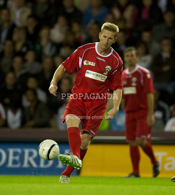 DERBY, ENGLAND - Thursday, September 8, 2011: Wales' Iwan Roberts in action against England during a legends match at Pride Park. (Pic by David Rawcliffe/Propaganda)
