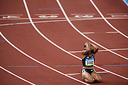 Lolo Jones of the U.S., holds her face in her hands following her seventh place finish in the women's 100 meter hurdles final on day 11 of the 2008 Beijing    Olympics, in Beijing, China on Tuesday, Aug. 19, 2008. Jones was leading the race when she tripped over the second-to-last hurdle, ending her hopes for a medal.
