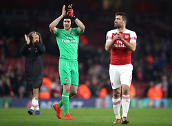 Arsenal goalkeeper Petr Cech (centre) applauds the fans after the final whistle during the UEFA Europa League round of 32 second leg match at the Emirates Stadium, London.