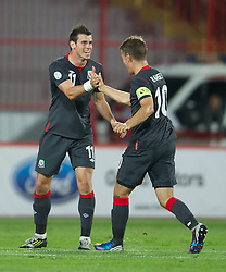 11.09.2012, Karadorde Stadion, Novi Sad, SRB, FIFA WM Qualifikation, Serbien vs Wales, im Bild Wales' Gareth Bale celebrates scoring the first goal against Serbia during FIFA World Cup Qualifier Match between Serbia and Wales at the Karadorde Stadium, Novi Sad, Serbia on 2012/09/11. EXPA Pictures © 2012, PhotoCredit: EXPA/ Propagandaphoto/ David Rawcliff..***** ATTENTION - OUT OF ENG, GBR, UK *****