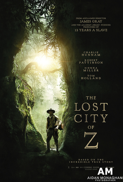 Charlie Hunnam Stars In Our Exclusive Poster For The Lost City Of Z<br /> Hunnam plays Percy Fawcett, a real-life adventurer who embarked on a voyage into the Amazon in 1925, ostensibly to map the area. After suffering from a nasty case of malaria, he claimed to have discovered a mythical city he called the Lost City of Z. His account dismissed as superstition, Fawcett returned to the jungle with a couple of trusted companions and headed back into the jungle to prove his point – never to be seen again.<br /> <br /> Also starring in the film is Edward Ashley as Arthur Manley, a young corporal who accompanied Fawcett on his apparently doomed expedition, Robert Pattinson as Henry Costin, another bored corporal who answered Fawcett's advertisement to become his aide-de-camp; Tom Holland as Fawcett's son Jack; and Sienna Miller is Fawcett's supportive wife, Nina.<br /> <br /> Adapted from David Grann's book of the same name, and directed by James Gray, The Lost City Of Z ventures on to UK screens on 24 March.
