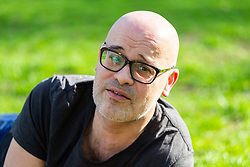 Carlo Fior, 47, an Italian Londoner gives his views on Brexit on Clapham Common in South London. London, March 24 2019.