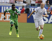 JACKSONVILLE, FL - JUNE 07:  Midfielder Michael Bradley #4 of the United States dribbles ahead of midfielder Ogenyi Onazi #17 of Nigeria during the international friendly match at EverBank Field on June 7, 2014 in Jacksonville, Florida.  (Photo by Mike Zarrilli/Getty Images)