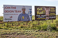 Billboard for Devon, a fracking company  in Eddy County New Mexico where the  fracking industry is booming.
