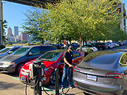 Tesla and Chevrolet Volt charging their batteries at an Electronic Vehicle charging stations in Portland Oregon