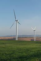 Wind Turbines on Columbia Plateau near Wasco Oregon. Mount Adams is in the distance