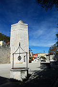 Square of Five Wells (Trg Pet bunara), with ancient city walls and medieval tower, Bablja Kula, in background. Zadar, Croatia
