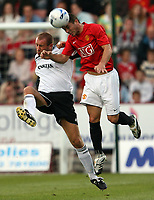 Photo: Paul Thomas. <br /> Dunfermline v Manchester United. Pre season Friendly.<br /> 08/08/2007. <br /> <br /> Phil Bardsley (R) of Utd battles with Jim Hamilton.