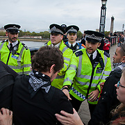 Some protestor left the Westminster Bridge and walked along the river and across Lambeth Bridge to get into Parliament Square. Police stopped them all on the North side from getting any further. Police enforcing kettling of the 20 odd protestors..The Health and Care Bill has been passed by Parliament and is due to go to the House of Lords. In protest against the bill which aim to deconstruct and privatise large parts of the NHS UK Uncut activists together with health workers and trade unionists blocked the Westminster Bridge from 1pm til 5.30pm.