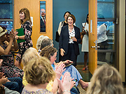 15 JULY 2019 - DES MOINES, IOWA: Senator AMY KLOBUCHAR (D-MN), left, greets people as she arrives at a roundtable about senior citizen issues in Des Moines. Sen. Klobuchar hosted a roundtable on issues important to older Americans at a community center in Des Moines. Klobuchar is running to be the Democratic candidate for President in the 2020 election. Iowa hosts the first event of the Presidential election cycle. The Iowa Caucuses are on February 3, 2019.         PHOTO BY JACK KURTZ