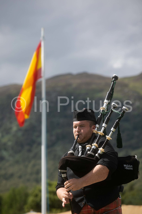 Highland Games, 3rd of August 2019, Newtonmore, Scotland, United Kingdom. A man plays his bag pipes as part of the best bag piper competition. The Highland Games is a traditional annual event where competitors compete as strong men, runners, dancers, pipers and at tug-of-war. The games go back centuries and are happening through-out the summer across Scotland. The games are both an important event locally and a global tourist attraction.