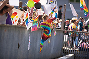 Leah Benning hangs over the Berth 3 trestle with a fist in the air in support of same a sex marriage and in protest to floral shop Heavenly Creations after the shop reportedly declined to provide floral services for a same sex marriage on Friday, June 5, 2020 in Ketchikan, Alaska.