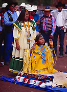Godmother Phoebe Cromwell with Carla Goseyun, the Burnette Singers and guests beyond, Carla Goseyun's White Mountain Apache Traditional Sunrise Ceremony, Whiteriver, Arizona.  Please Note: A small extra licensing fee needs to be paid to the Goseyun Family for usage of this photo. Contact Fred Hirschmann for more information. Thanks.