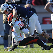 L.J. Hunt, Yale, makes a stop during the Yale Vs Princeton, Ivy League College Football match at Yale Bowl, New Haven, Connecticut, USA. 15th November 2014. Photo Tim Clayton