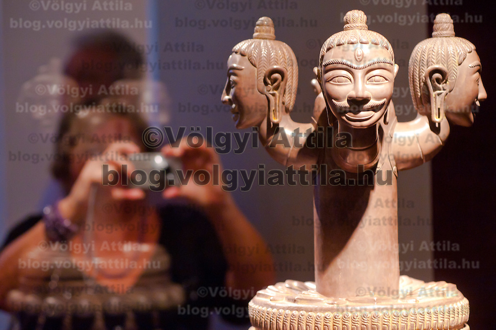 Visitor takes a picture of an artifact in the Southeast Gold Museum that presents hundreds of golden artifacts from the private collection of founder Istvan Zelnik in Budapest, Hungary on September 15, 2011. ATTILA VOLGYI